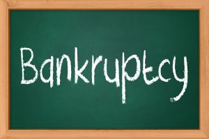 Bankruptcy on chalkboard for discussion about personal injury claims