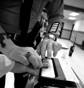 arrestee giving fingerprints before calling a criminal defense lawyer