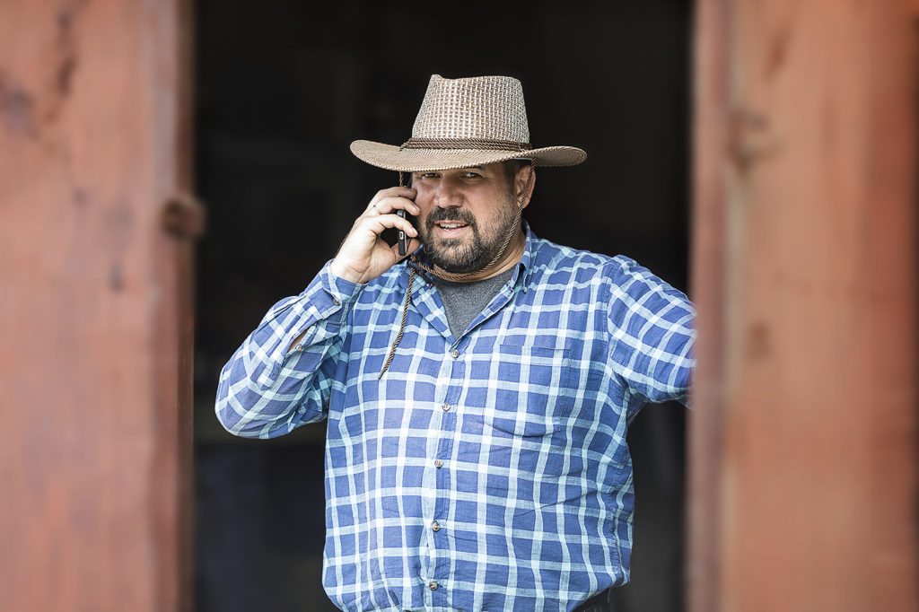 cowboy on cell phone with criminal attorney